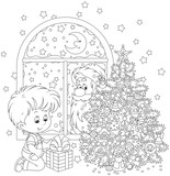The night before Christmas, Santa Claus peeking in a window and watching a little boy with his gift near Christmas tree, a black and white vector illustration for a coloring book