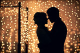 Fototapety Silhouettes of lovers on a background garlands