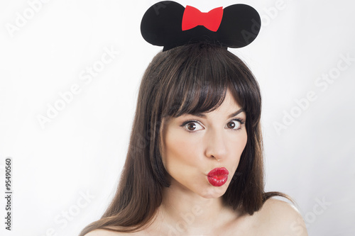 Woman kissing wearing a mouse ears accessory Poster