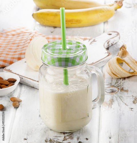 """Healthy Banana smoothie on white wooden table."""" Stock photo and ..."""