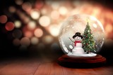 Fototapety Christmas tree and snowman in snow globe