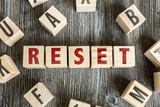 Wooden Blocks with the text: Reset