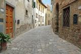 Fototapety paved narrow street in italian village, Tuscany