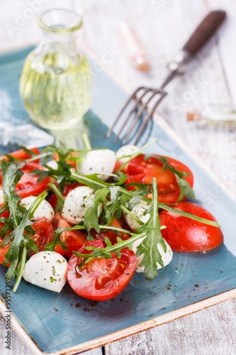Vegetable salad,cherry tomatoes,, mini mozzarella, arugula. selective focus