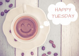 Fototapety Happy Tuesday with coffee cup on table