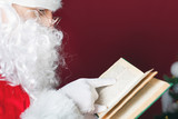 Santa Claus reading book with christmas fairy tale