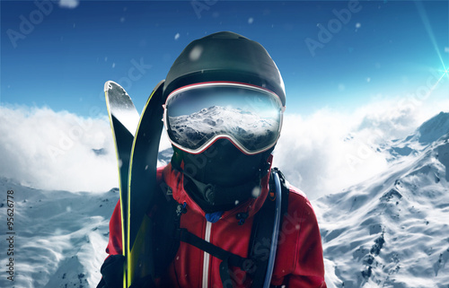 Skier in front of mountain landscape Poster