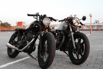 Two vintage motorcycle in parking lot during sunset © Kaponia Aliaksei