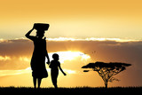African woman and son at sunset - 95654906