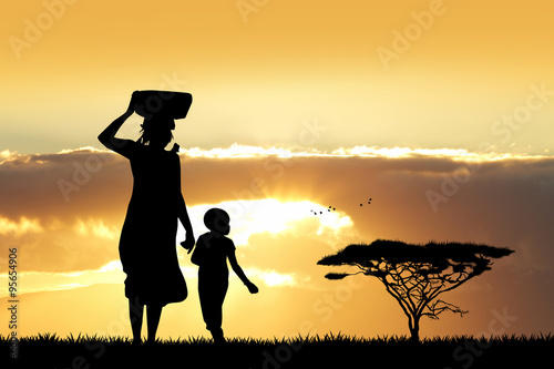 African woman and son at sunset