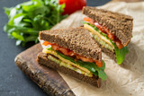 Fototapety Vegan sandwich with salad and cheese