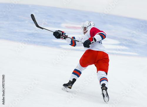 fototapeta na ścianę Ice Hockey - Player makes a slap shot