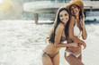 Beautiful girls enjoying summer and sea water