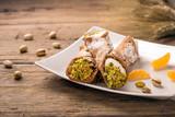 Sicilian cannoli stuffed with ricotta cheese and pistachio, traditional Sicilian dessert, Italian pastry