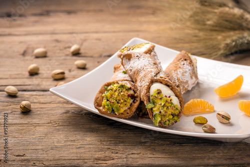 Aluminium Palermo Sicilian cannoli stuffed with ricotta cheese and pistachio, traditional Sicilian dessert, Italian pastry