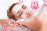 Fototapety Beautician Applying Mask On Customer's Face At Salon