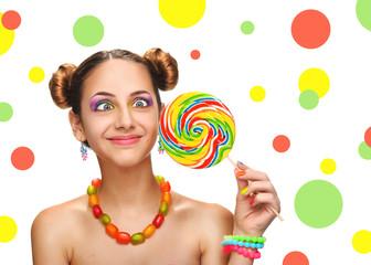 Girl eating colourful lollipop. Lollipop.