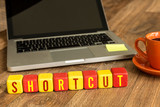 Shortcut written on a wooden cube in a office desk