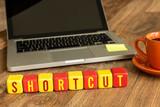 Shortcut written on a wooden cube in a office desk