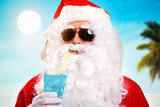 Santa Claus relaxing on a tropical beach after Christmas