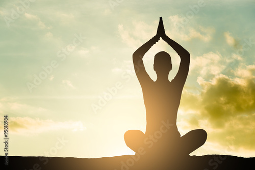 Yoga silhouette outdoor at sunset плакат