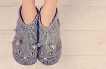 Close up of woman feet  wearing cozy warm wool socks. Warmth concept. Winter clothes
