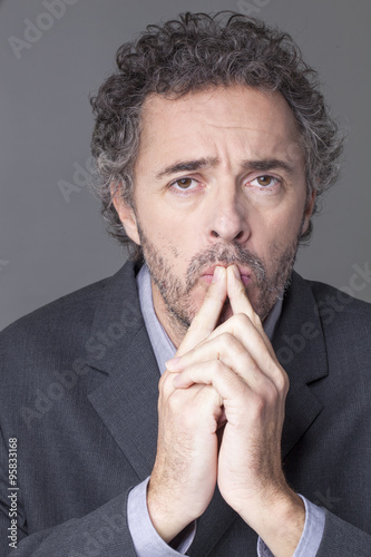 Poster doubt and worry concept - portrait of concerned mature businessman thinking abou