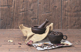 Mortar with pestle and a vintage Cup with coffee beans on homesp