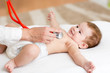 Obrazy na płótnie, fototapety, zdjęcia, fotoobrazy drukowane : Baby having it's heartbeat checked by doctor pediatrist