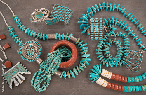 "Collection of Vintage Native American Jewelry . A Santo Domingo ""Depression Era"" Necklace, and Turquoise ""Nugget"" necklaces with silver beads, and Zuni and Navajo Bracelets, Grey Slate Background."