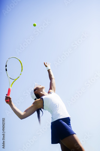 Plakat Beautiful female tennis player serving