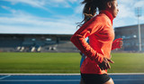 Fototapety African female athlete training on race track