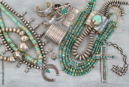 A collection of Vintage Native American Jewelry made of Turquoise and Sterling Silver Poster