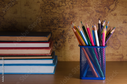 color pencil box on wooden table Poster