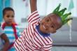 Obrazy na płótnie, fototapety, zdjęcia, fotoobrazy drukowane : Smiling boy with party hat