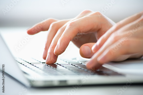 Close-up of hands of business man typing on a laptop. плакат