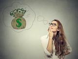 Woman dreaming of financial success - 96195768
