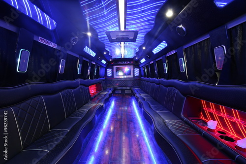 a big party bus fill ed with comfortable seats and shiny bright floor for dancin