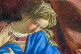A detail of an old cracked painting of the Virgin Mary in the moment of Anunnciation - 96268584