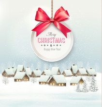Holiday Christmas background with a village and  gift card with