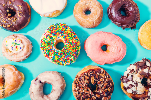 Assorted donuts on pastel blue background Poster