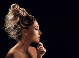 Fototapety Portrait of Beautiful Young Woman with hairstyle touching her fa