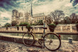 Retro bike next to Notre Dame Cathedral in Paris, France. Vintage