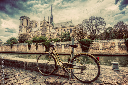 Retro bike next to Notre Dame Cathedral in Paris, France. Vintage Photo by Photocreo Bednarek