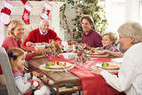 Fototapety Family With Grandparents Enjoying Christmas Meal At Table