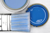 Fototapety Top view of blue paint can with brush on grey metal background