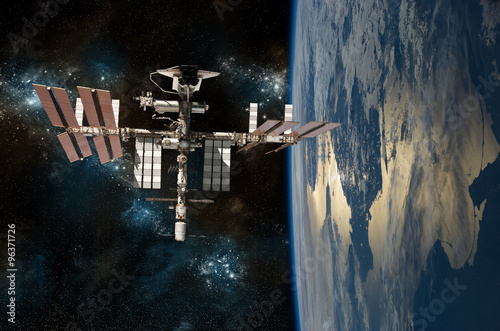 Fotobehang Nasa The International Space Station Orbiting Earth with the space shuttle docked. - - Elements of this Image Furnished by NASA.