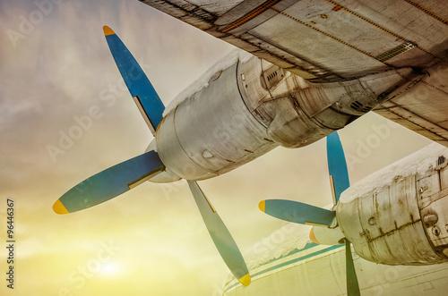 Fototapeta plane flying into the sunset