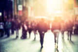 Fototapety people walking in the street, blurry