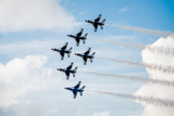 Fototapety USAF F-16 Thunderbirds Flying Above the Clouds